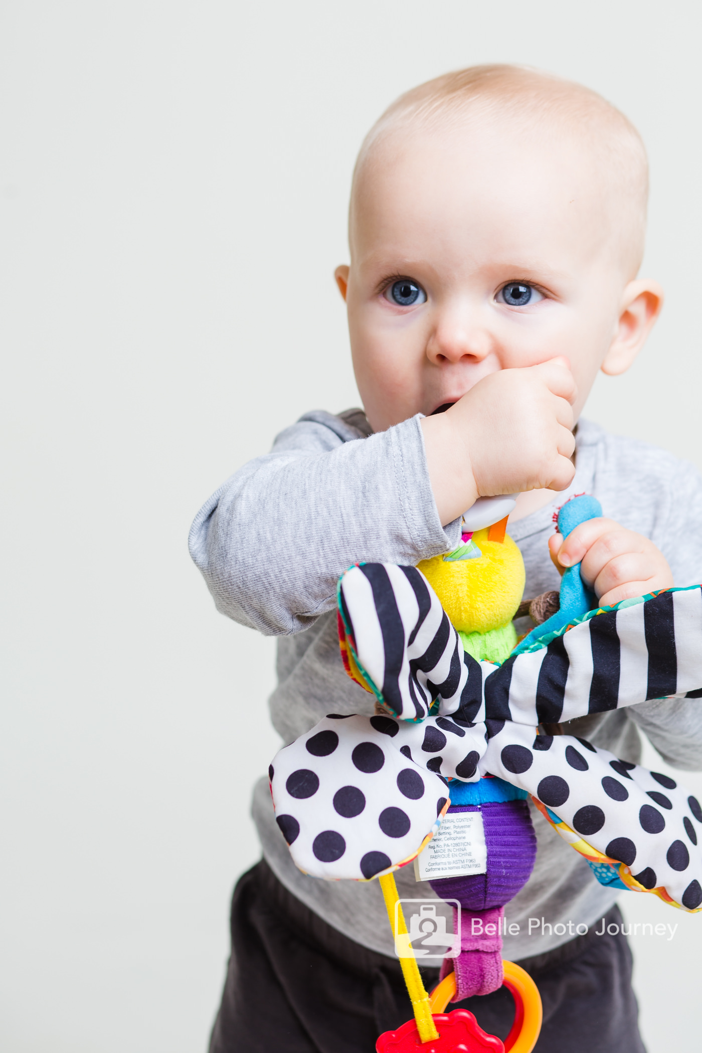 9 10 nine ten months old baby playing with toys