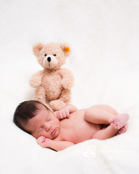 baby curling up next to teddy bear highgate photographer