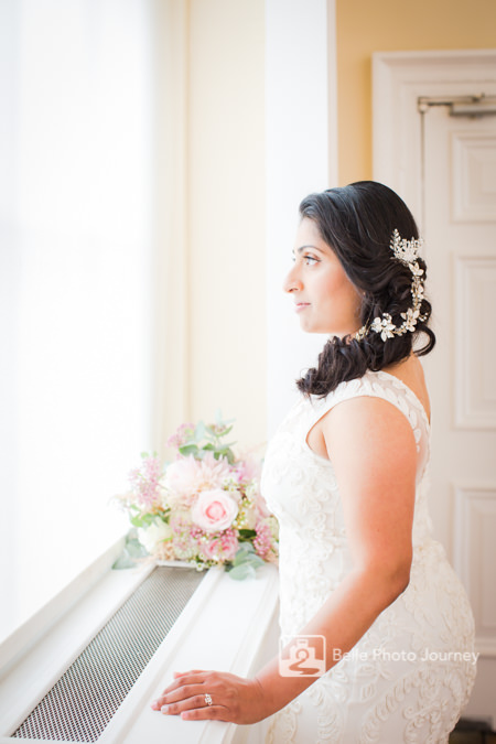 Bride getting ready, looking out of window