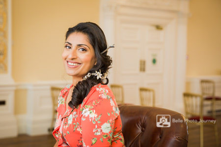 Happy bride at her bridal preparation - smiling at camera