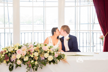 wedded couple signing at registrar