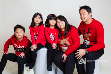 Family wearing christmas jumpers