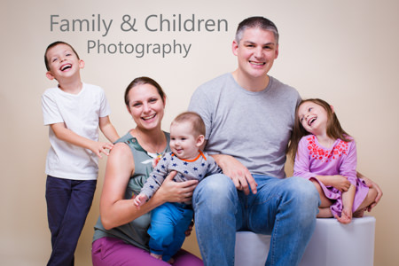 Family of five laughing - Crouch End photo studio