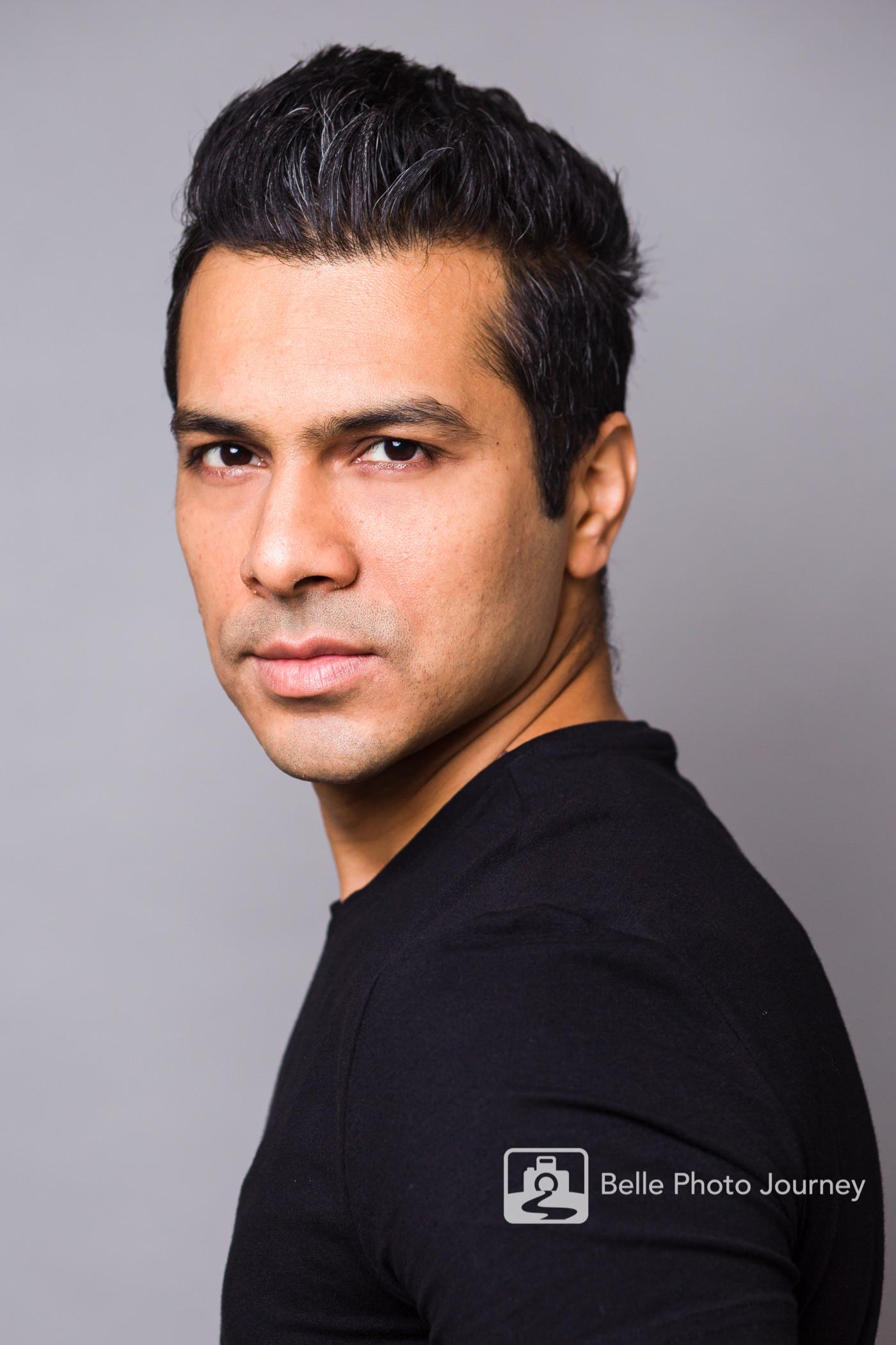 asian actor black t shirt spotlight profile photo