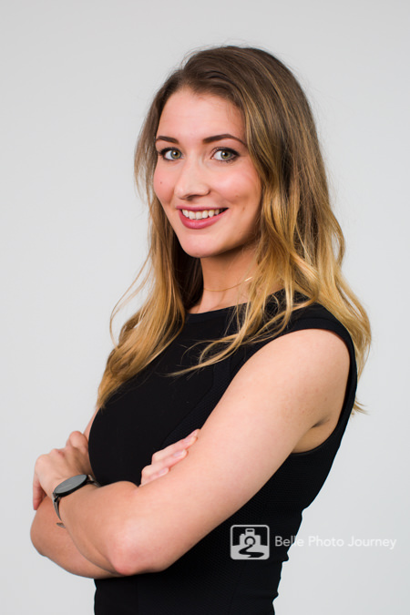 blonde female black dress confident profile photo