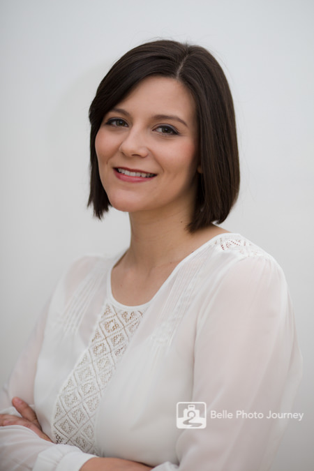 corporate head shot female executive in white shirt