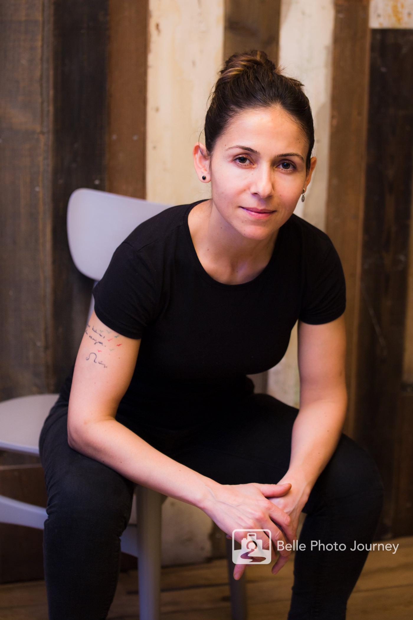 female chef in black restaurant background