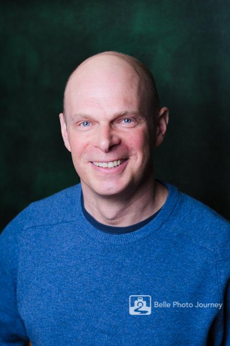 man in casual wear blue jumper head shot