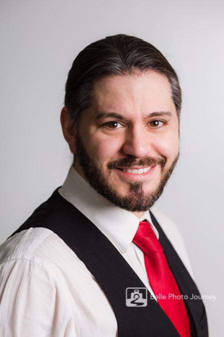 man with red tie waist coat