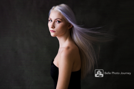 Model with platinum blonde hair flying