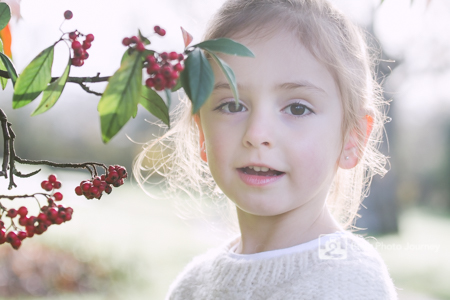 Child portrait in park - winter xmas berries