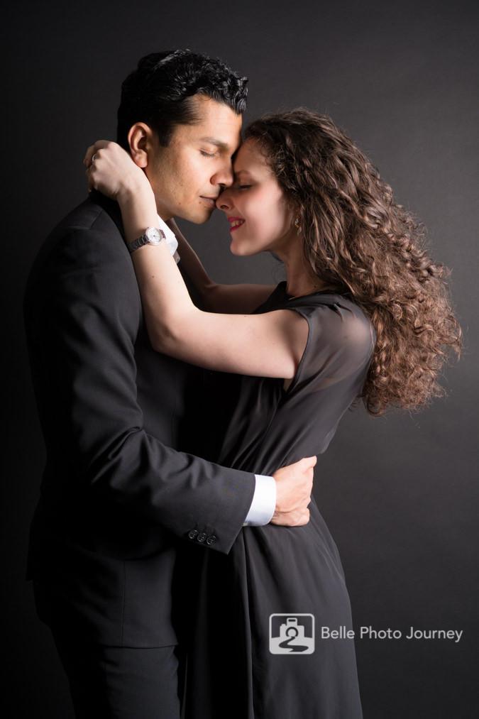 Couple in love studio photo in black