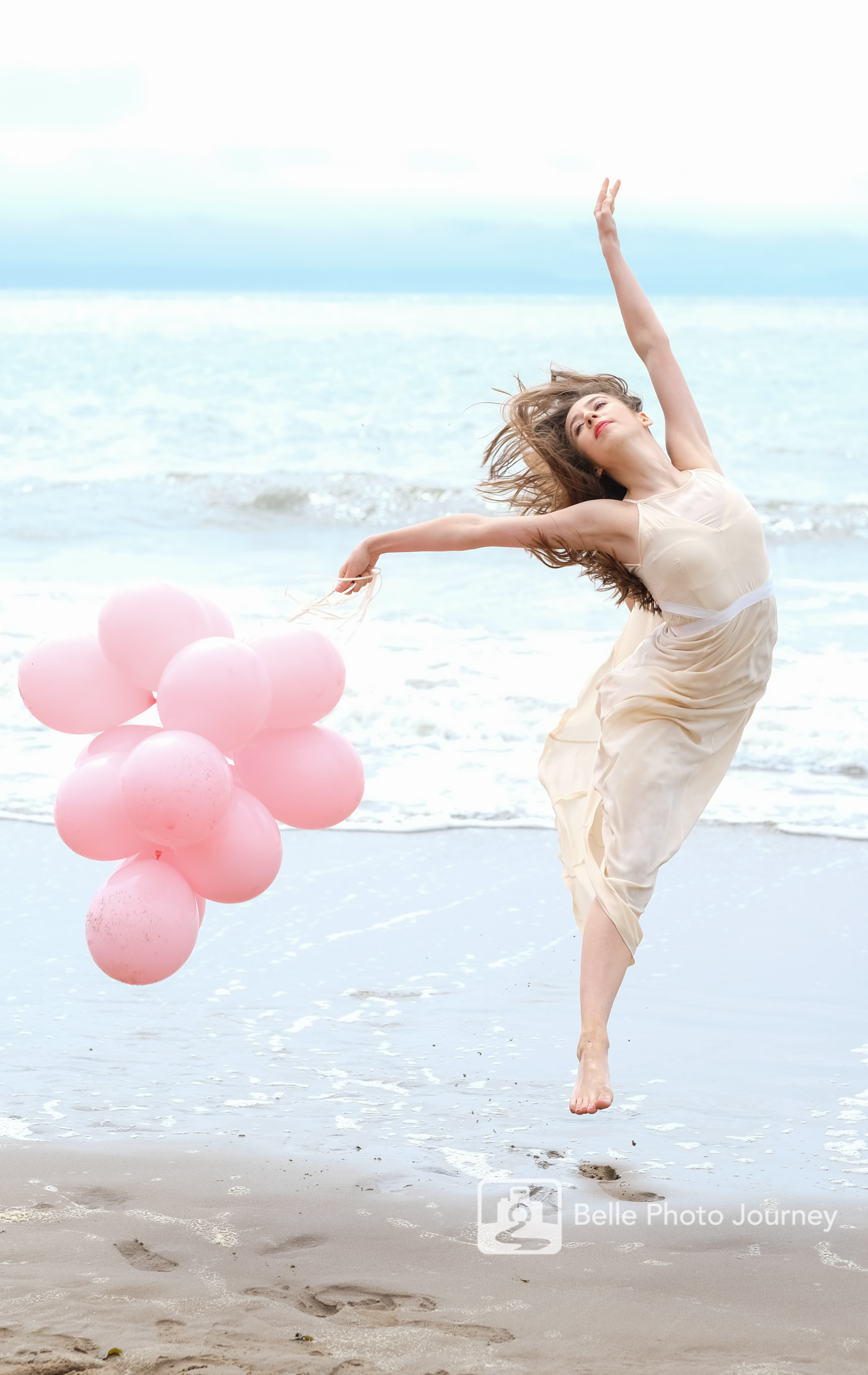 ballerina portrait jumping on the beach with balloons