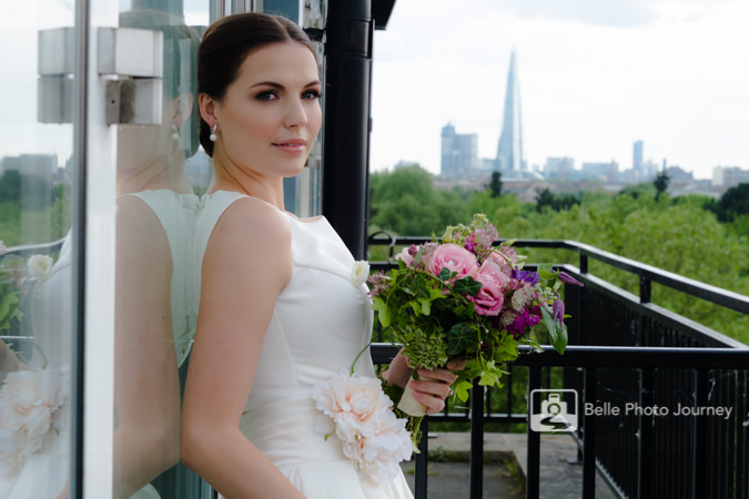 bride on balcony london landmark shard in background