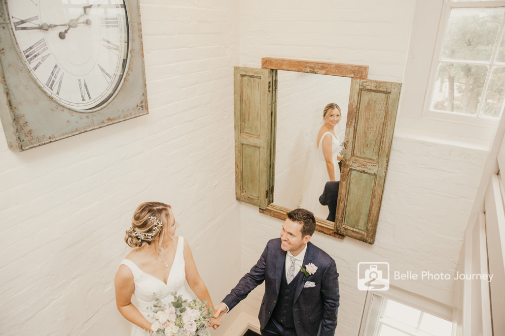 couple portrait vintage boho style staircase sopley mill