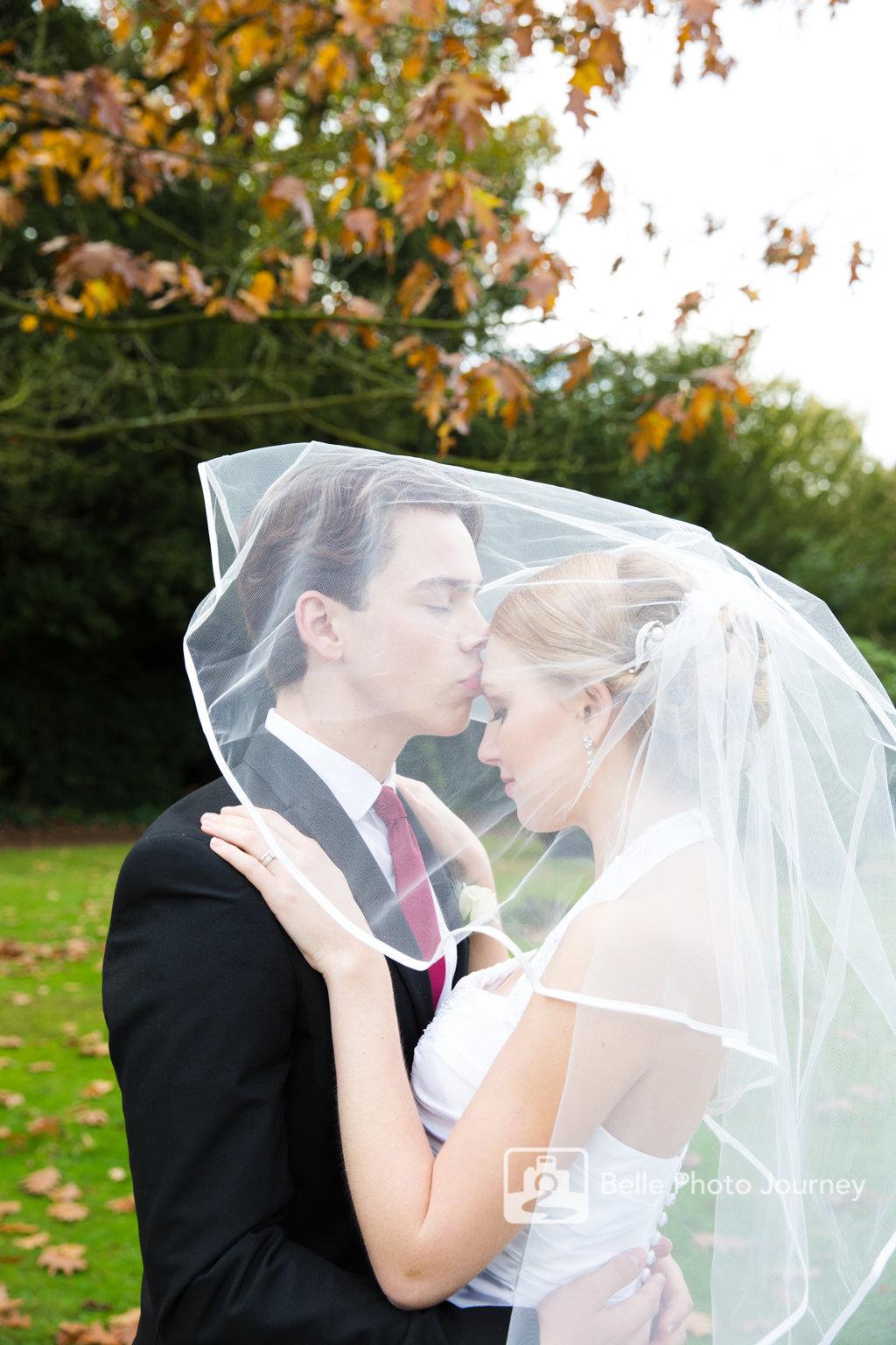 garden wedding portrait autumn bride veil over groom