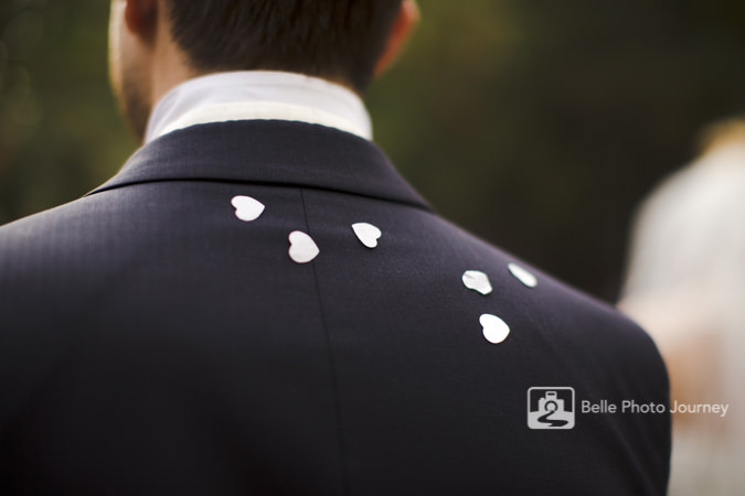 heart shape confetti on black suit