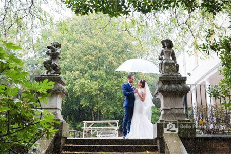 wedding in rain white umbrella lauderdale house garden highgate london