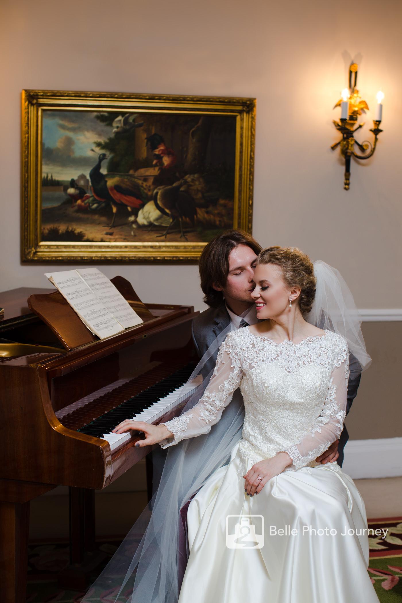 wedding portrait piano oil painting groom kissing bride london photographer